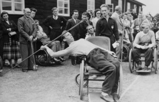 "(Original Caption) Joep de Beer of Doorn, Holland, leans into the javelin from his wheelchair during the Stoke Mandeville Games for paraplegic contestants. It was Britain's third international sports festival for men and women paralyzed from the waist down due to spinal injuries. Winners were awarded trophies in the special ""Olympics"" event."